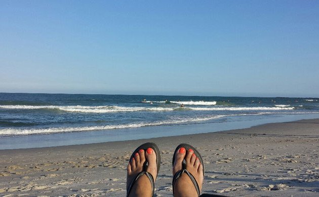 a friend's happy feet when she followed her impulse for play while finishing up her work week and phone calls - at the beach